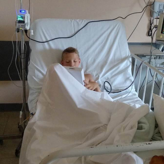 Health and Community Support - boy in hospital bed